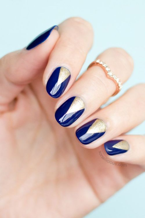 navy and gold graphic nails